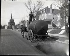 Street oiling truck at work on Union Boulevard near the entrance of Washington Terrace. Photograph probably taken between 1900 and 1910. Swekosky Notre Dame College Collection, Missouri History Museum.