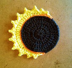 Designed to give to each person as a party favor at an upcoming Eclipse Party, this coaster is a crocheted, worsted weight rendition of a partial solar eclipse.