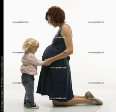http://www.photaki.com/picture-child-and-pregnant-mother_287391.htm