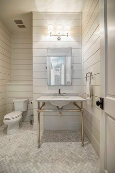 Tongue and groove bathroom. Tongue and groove wall bathroom. White Tongue and groove bathroom walls. Flooring is mini marble tile set in herringbone pattern. #Tongueandgroove #bathroom #Tongueandgroovebathroom Geschke Group Architecture.