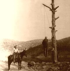 Antique photo of a man hanged in the Old West.