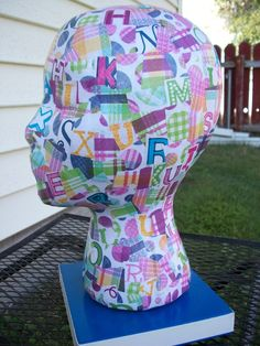 Decoupage a styrofoam head. DIY. Did it and it was so much fun. Just careful with the type of paper you use and the amount of decoupage used because it can run the colors of the paper. ~Wendy