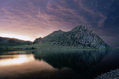 Mountain by a lake at sunset. ~ Mongolia