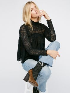 About Time Top | Ultra femme long sleeve babydoll top featuring a cute crochet design. High mock neck with back button closures and a keyhole cutout.