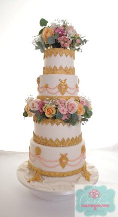Oppulent gold and peach wedding cake by Cakes o'Licious - http://cakesdecor.com/cakes/237427-oppulent-gold-and-peach-wedding-cake