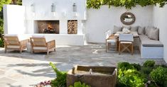 "This larger patio space designed by molly wood garden design is composed of two ""rooms"". there's the conversation grouping in front of the outdoor fireplace"