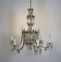 Pair of Regency Six-Arm Brass and Crystal Chandeliers | From a unique collection of antique and modern chandeliers and pendants  at https://www.1stdibs.com/furniture/lighting/chandeliers-pendant-lights/