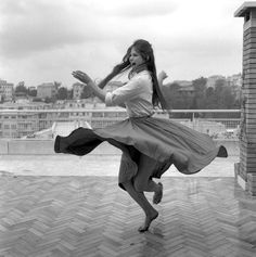 Claudia Cardinale dancing barefoot on a roof terrace in Rome [1959]