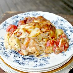 Tomatoes, artichokes, parmesan & mozzarella cheese cover seasoned chicken breasts for a simple, and delicious meal.