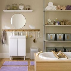 Keeping a bathroom tidy, neat and organized can feel like a losing battle. One stray toothpaste cap, a bright orange bottle of Metamucil and a sticky soapdish and the room can quickly appear grungy and cluttered. But with a little planning and some basic maintenance, you can make your bathroom cool, calm and collected. Here are 8 of my favorite tips and strategies for containing bathroom chaos.