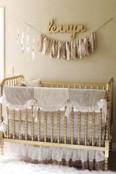 Jenny Lind Crib Painted Gold - Fun DIY project for a baby nursery! The bedding is perfect too!