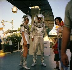 Vintage Disneyland!  Check out these space-age astronauts visiting with guests under the monorail track at Disneyland!