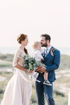 Bride and Groom with their son. Photography by http://mariasundin.com