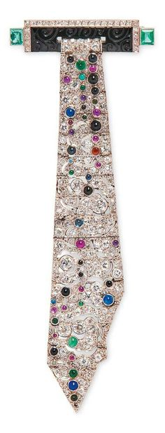 An Art Deco Platinum, Diamond and Gem-set Brooch, designed as a necktie.