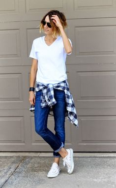Shop this look on Lookastic: http://lookastic.com/women/looks/sunglasses-v-neck-t-shirt-dress-shirt-skinny-jeans-low-top-sneakers/7646 — Dark Brown Sunglasses — White V-neck T-shirt — Navy and White Gingham Dress Shirt — Blue Skinny Jeans — White Low Top Sneakers
