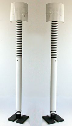 A pair of monumental Shogun Terra floor lamps designed by Swiss architect Mario Botta in 1986, originally manufactured by Artemide but no longer in production. The base is black cast iron with a powder coated white and black striped shaft. The remarkable design of two curved, perforated metal shades can be pivoted to cast an almost endless variation of pattern in light and shadow. Image © Eclectisaurus. Visit our shop at 249 Gerrard St E, Toronto. 416-934-9009 www.eclectisaurus.com