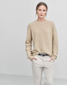 Luxurious loose fit Crew-neck pullover in 100% recycled cashmere. Shaped bottom that's slightly longer at the back. Vertical seam detail that runs down the center of the back. <br> <br> - Luxe Recycled Cashmere <br> - Shaped bottom, longer at the back