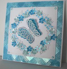 ...by Marjorie Ramsay - Embossalicious  Picnic Plaid Embossing Folder  - .Ocean Teal & Pearl Lustre gilding polish - Petite peony cluster  - Magical butterflies.