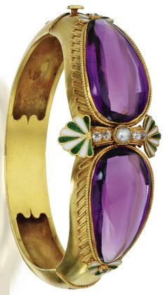 An Antique Gold, Amethyst, Diamond, Pearl and Enamel Bangle-Bracelet, Carlo Giuliano, Circa 1874-1895. Set in the centre with a line of old mine diamonds and a pearl, accented by stylized palmettes applied with green and white champlevé enamel, flanked by cabochon amethysts with faceted undersides, within beaded gold bezel surrounds accented by applied gold wire fringe, signed C.G for Carlo Giuliano. #Giuliano #antique #bracelet