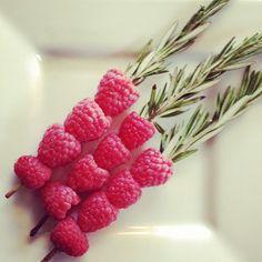 drink garnish idea: raspberries and rosemary