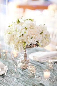 Beautiful center pieces. It keeps the wedding tables clean and simple; not too much clutter from the colors.