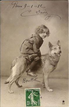 Child Riding German Shepherd.