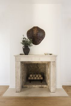 Living Room in Hancock Park by Jeremiah Brent Design Distressed Fireplace, Grand Stairway, Jeremiah Brent, Hancock Park, Hummingbird Painting, Nate Berkus, Design Firms, Decoration, House Design