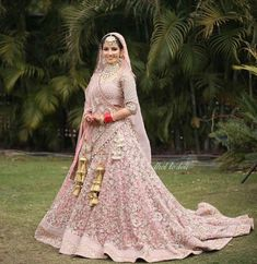 A pink lehenga is a dream outfit in every bride's wardrobe! Especially if that bride has a 'pink fever'! Check out some stunning lehengas in pink for major inspo! Golden Bridal Lehenga, Pink Bridal Lehenga, Pink Lehenga, Indian Bridal Lehenga, Golden Lehnga, Lehenga Choli, Saree, Wedding Lehenga Designs, Wedding Lehnga