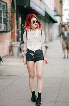 chic blouse with grunge shorts