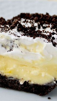 Oreo Cake Recipe ~  It's really not a cake at all, but creamy layers of whipped cream, cream cheese and pudding on an Oreo crust.