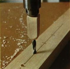 Why spend money for a fancy drill stop? This will work on a drill press too.