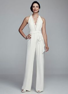 Perfect for a trendy bride wanting to make the ultimate fashion statement on her special day!  Halter crepe jumpsuit features a lace trim deep v-neckline with lace back.  Removable sash at waist.  Fully lined. Imported. Back zip. Dry clean only.  To protect your dress, try our Non Woven Garment Bag.