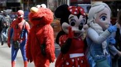 Image copyright                  AP                  Image caption                     The costumed characters may have a smaller area to work in   New York City's council is considering legislation to restrict where performers dressed as characters like Elmo and Spiderman can solicit business. The costumed performers now roam freely in Manhattan's busy Times Square, the heart of the theatre district. The council is mulling rules for pedestrian