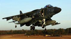 Maj. James S. Tanis lands an AV-8B Harrier during field carrier landing practice…