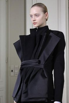 Sleek, sculptural tailoring - jacket with multiple folded collars; dimensional detail // Rad Hourani