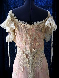 Wedding Dress (detail): ca. early 1900's, cutwork and tambour embroidery, appliqued lace, net, cotton, ribbons, ruffles. (Was for sale on eBay. In a private collection as far as is known.)