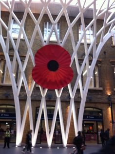 Large poppy at Kings Cross on Armistice Day
