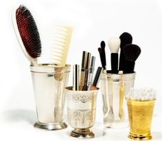 Use julep glasses to store brushes, q-tips, etc- image via Vogue.com