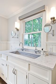 Beautiful bright bathroom! #sink #marble #cabinets