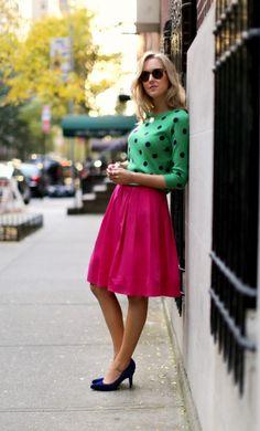 Lime 1/2 sleeve top w/ black polka dots, magenta midi, purple pumps, shoulderlength wavy blonde hair, large black eyeshades