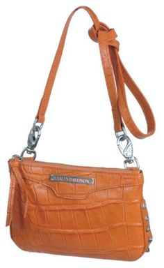 "$72.00 Handbags  Harley-Davidson® Women's Orange Croco Hip Bag Purse Handbag. Adornments. OC4422L-ORG - Orange Croco Embossed genuine Leather. Stunning Gold Leopard lining. Brushed nickel logo plate with orange fill inlay, hexagon stud details. Accompanied with sculpted H-D® medallion hanging charms. Signature script H-D® logo plate. Highest quality and great looks you'll love! Measures 8"" x 5.5""  ..."