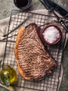Fiorentina Steak: We continue our gastronomic tour in Tuscan Romagna and the main course is almost a must: a tasteful and rare cooked Fiorentina Steak, thick more than 2 inches. I guess no one need special guidance on this recipe. #Steak #Alessandro_Guerani #foodografia