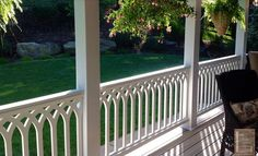 vinyl porch railings in cathedral pattern on front porch