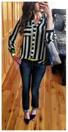 Black and white striped top with lots of bright colored accessories and a bright blue trimmed Louis Vuitton Neverfull GM