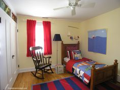 Nautical theme bedroom boys with sailboat picture sailing flag comforter and pillows striped rug sailboat mobile and Storage bins space above closet  http://www.tourfactory.com/847549