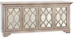 August Buffet sold by Lillian August august buffet ITEM NO. 1271073 DETAILS + DIMENSIONS Antique mirror front Four doors Four shelves Finish: Metallic starlight b L73W21H34 Special Order Info: Also available in additional finishes