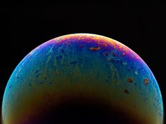 Photographer Jason Tozer Turns Soap Bubbles into Mysterious, Colorful Planets