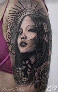 Tatuaje de estilo black and grey de una geisha, situado en el brazo izquierdo.