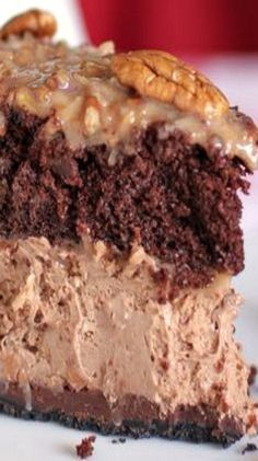 This dessert is pretty much a double chocolate cheesecake topped with a modest layer of German chocolate cake. And no, we're definitely not complaining. Get the recipe from Willow Bird Baking. Just Desserts, Delicious Desserts, Dessert Recipes, Yummy Food, Cold Desserts, Gourmet Desserts, Health Desserts, Plated Desserts, Dinner Recipes
