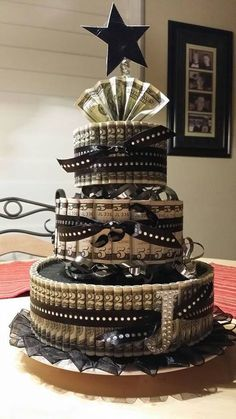 "Black and Gold ""Money"" Cake - love the use of $2 bills! Maybe progress to higher bill amounts from bottom to top similar to this. ***Update: check out my version of the money cake under my ""My Creations!"" Board! I love the way it turned out :)"